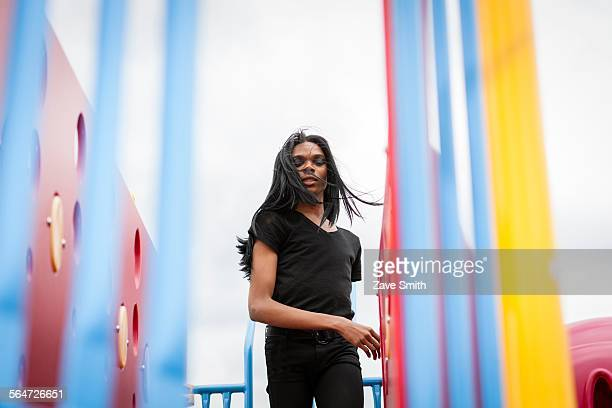 young man with long hair in playground - black transgender stock pictures, royalty-free photos & images