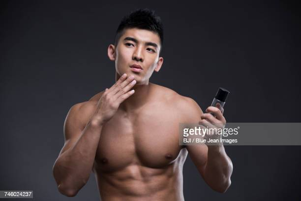 Young man with moisturizer