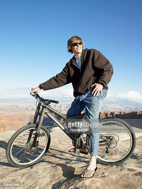 Young man with mountain bike