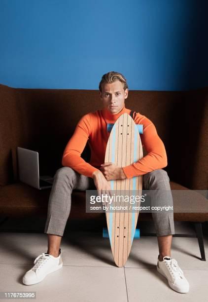young man with notebook - surfing the internet - sports round stock-fotos und bilder