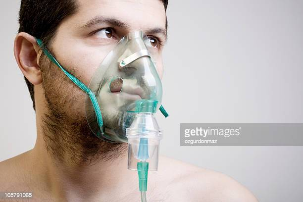 young man with oxygen mask - breathing device stock pictures, royalty-free photos & images