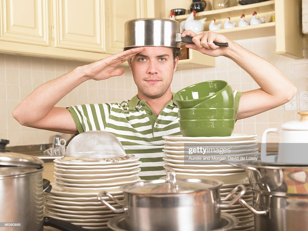 young man with pan on head : Stock Photo