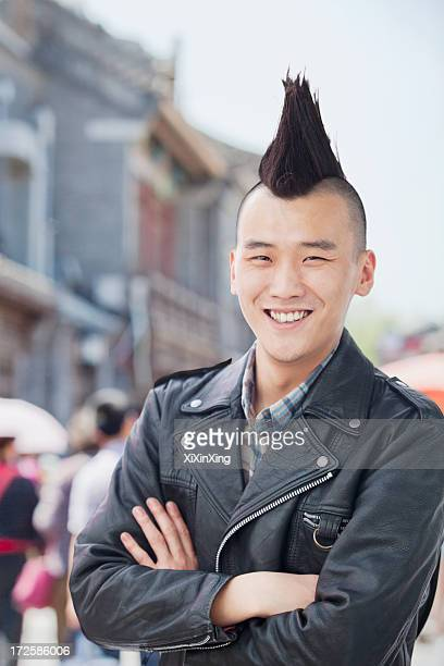 young man with punk mohawk portrait - mohawk stock pictures, royalty-free photos & images