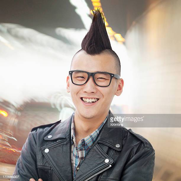 young man with punk mohawk smiling - mohawk stock pictures, royalty-free photos & images