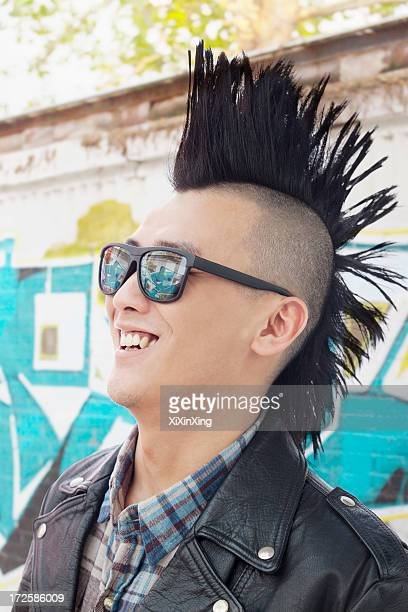 Young man with punk Mohawk smiling