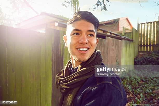 young man with quiff looking away, smiling - ポンパドール ストックフォトと画像