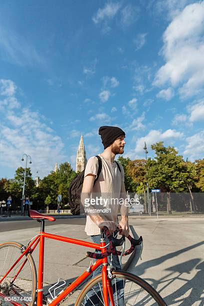 Young man with racing cycle in Vienna