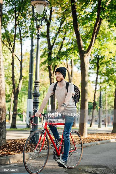 Young man with racing cycle on bicycle lane in Vienna, Dr.-Karl-Renner-Ring