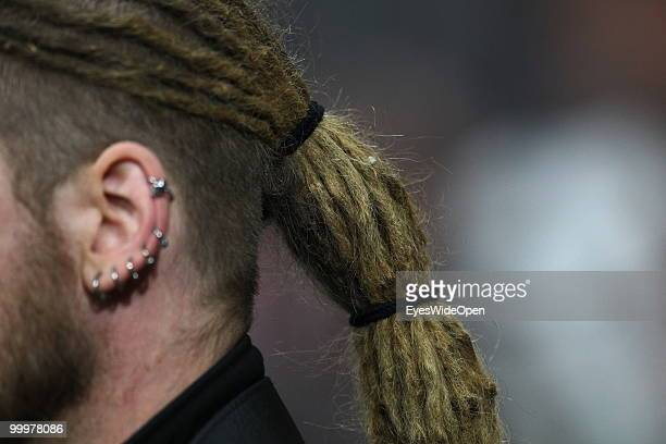 Young man with rastafarian hair styling and ear piercings on May 09 2010 in Munich Germany