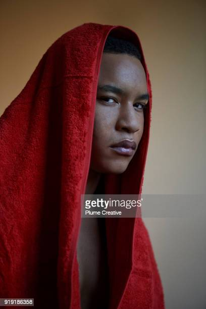 Young man with red towel over head