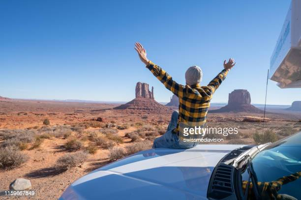young man with rental motor home enjoying road trip in usa - national park stock pictures, royalty-free photos & images