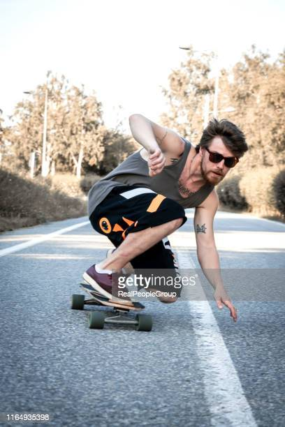 young man with skateboard - skating stock pictures, royalty-free photos & images