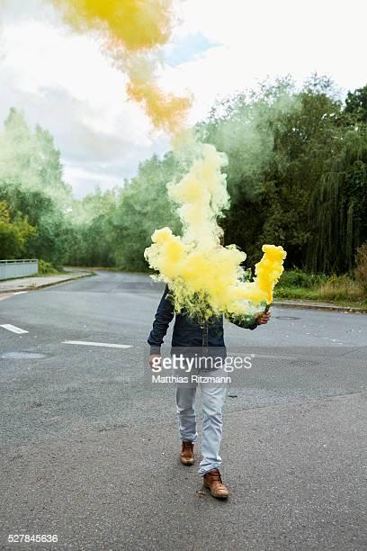 Young man with smoke