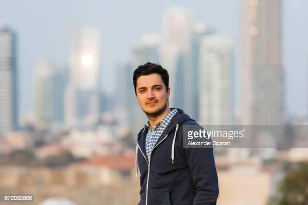 Young man with Tel Aviv skyline background