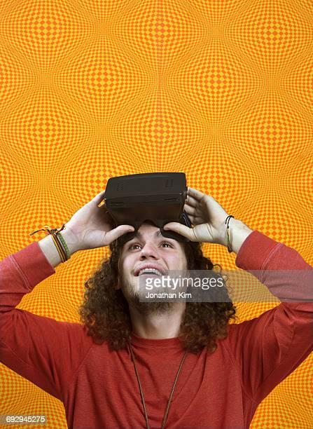 Young man with vitural reality headset.