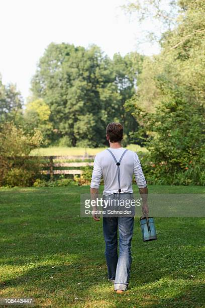 Young man with watering can