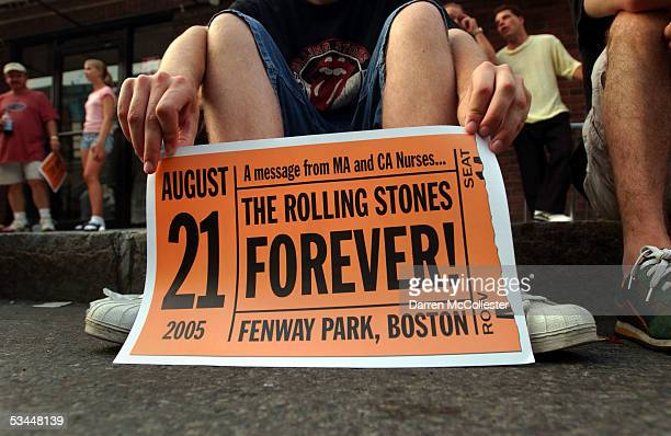 A young man without a ticket sits outside Fenway Park on opening night of the Rolling Stones 'A Bigger Bang' tour August 21 2005 in Boston...