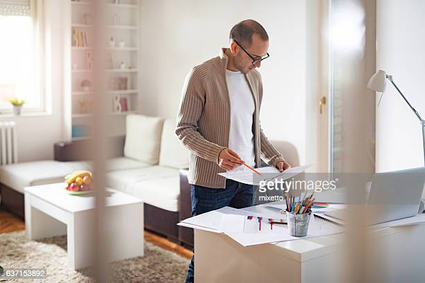 Young man work at home
