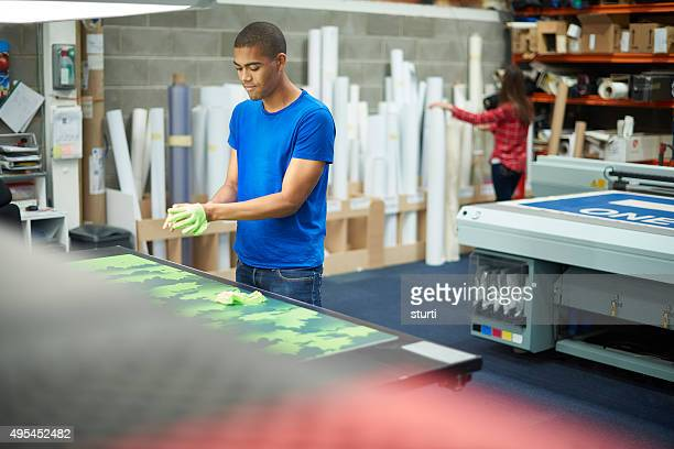young man working at a signage company