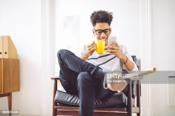Young man working at home office