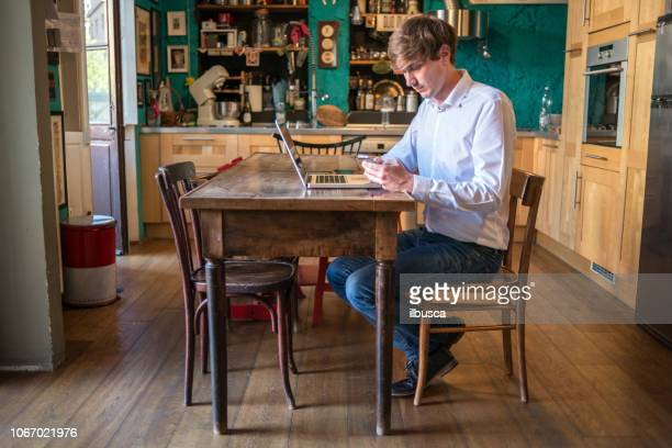 Young man working at home on laptop