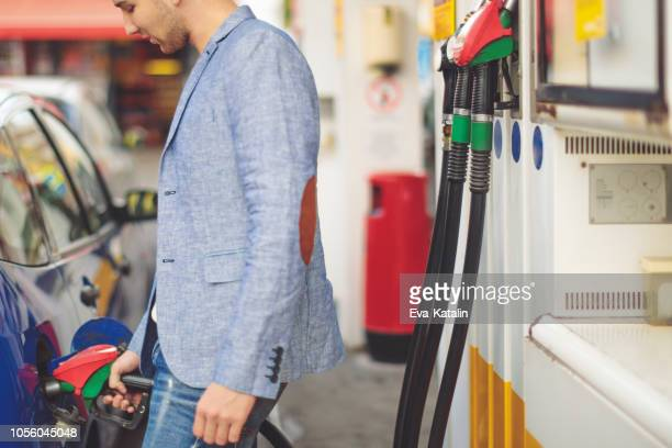 young man working at home - refuelling stock pictures, royalty-free photos & images