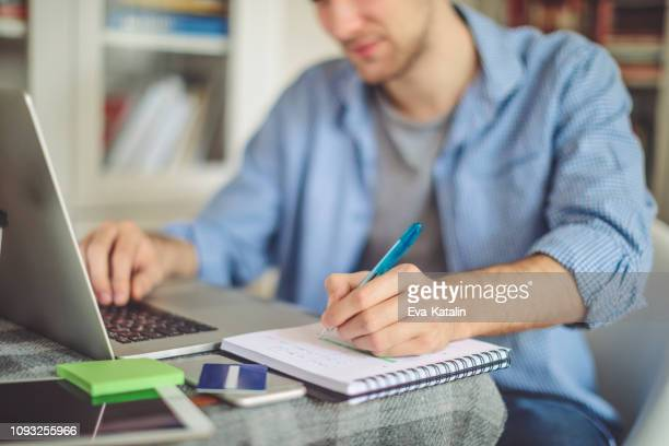 young man working at home - studying stock pictures, royalty-free photos & images