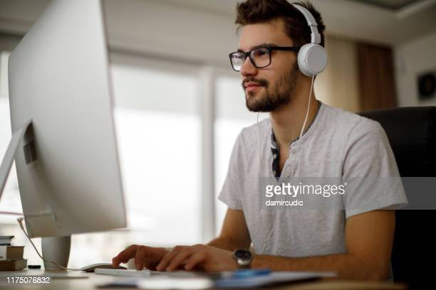 young man working at home - tutorial stock pictures, royalty-free photos & images