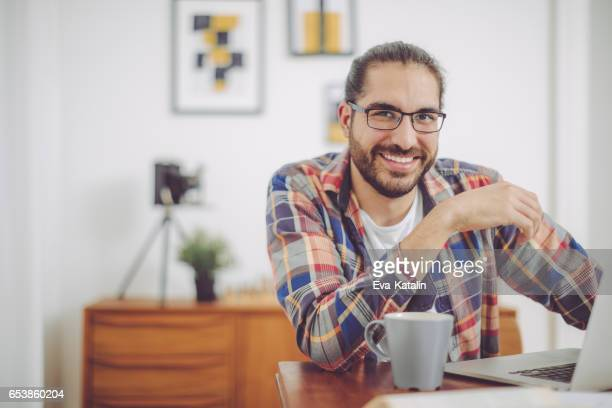 young man working at home - man bun stock pictures, royalty-free photos & images