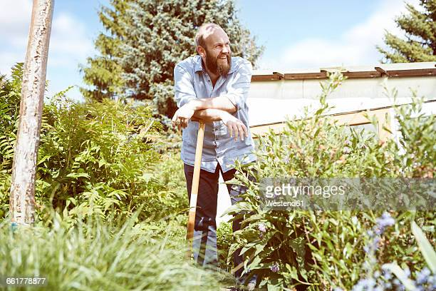 young man working garden - gärtnern stock-fotos und bilder