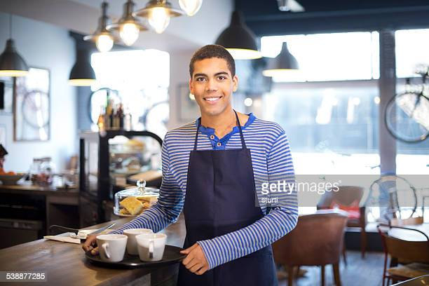 young man working in a coffee shop