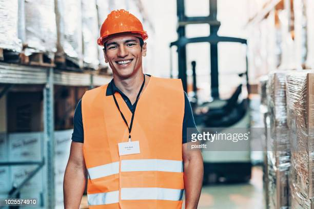 Young man working in a warehouse