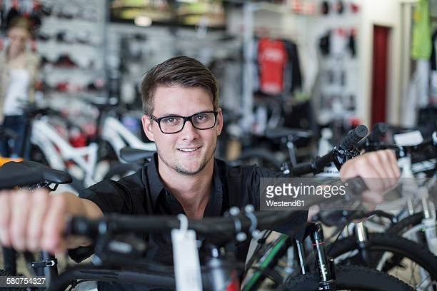 Young man working in bicycle shop