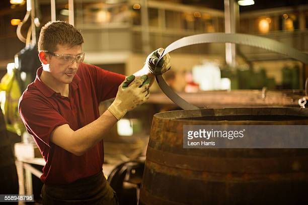 Young man working in cooperage