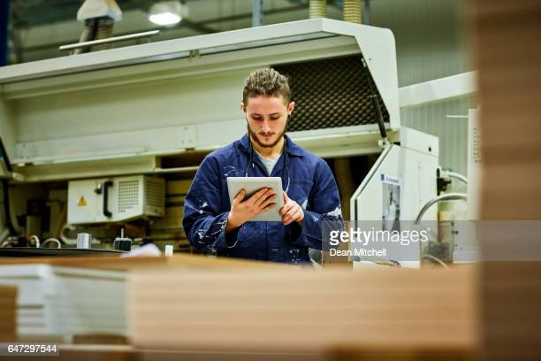 Young man working in factory