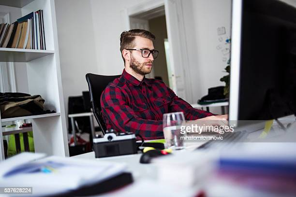 Young man working in his office