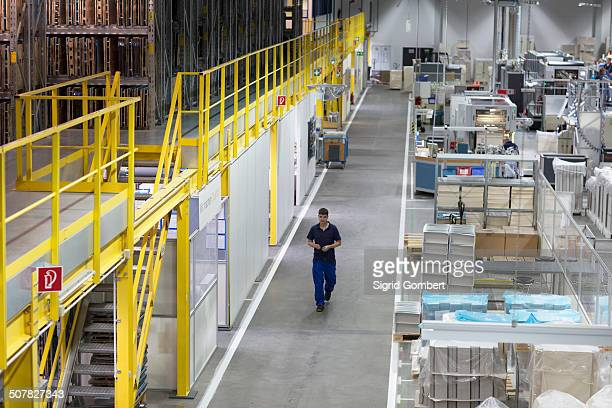 young man working in paper packaging factory - sigrid gombert stock pictures, royalty-free photos & images