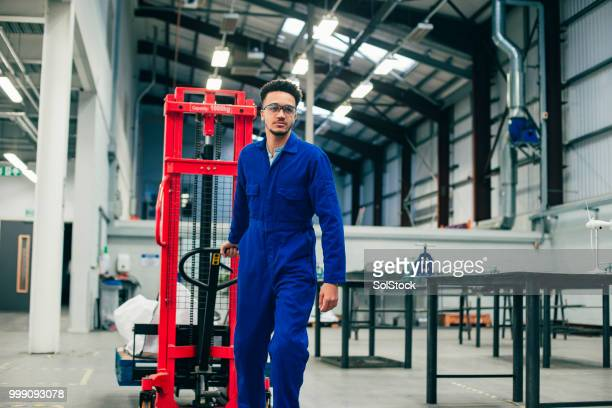 Young Man Working in the Engineering Workshop