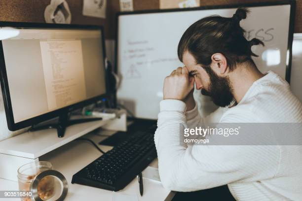 Young man working late from home office