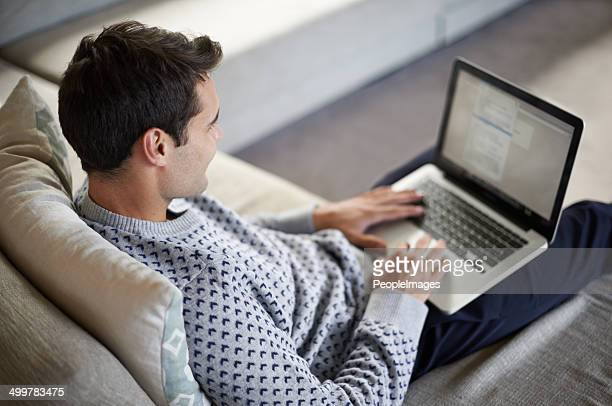 giving his fingers a workout - surfing the net stock photos and pictures