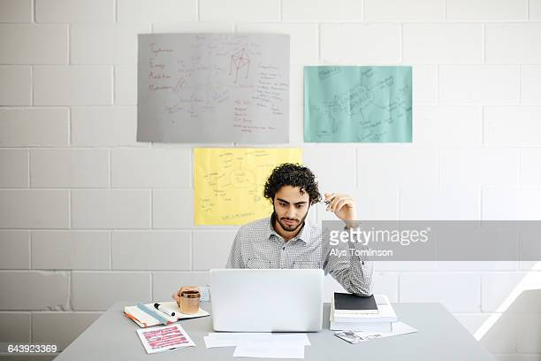 young man working on laptop in studio
