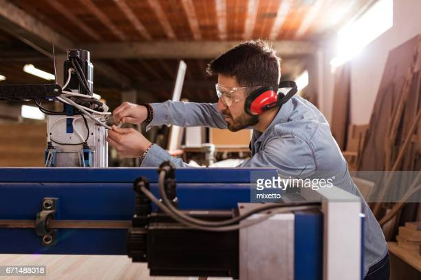 Young man working on the cnc machine