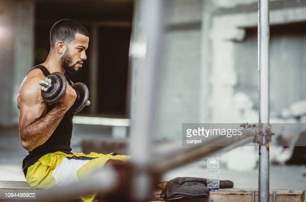 young man working out in the gym - weight training stock pictures, royalty-free photos & images