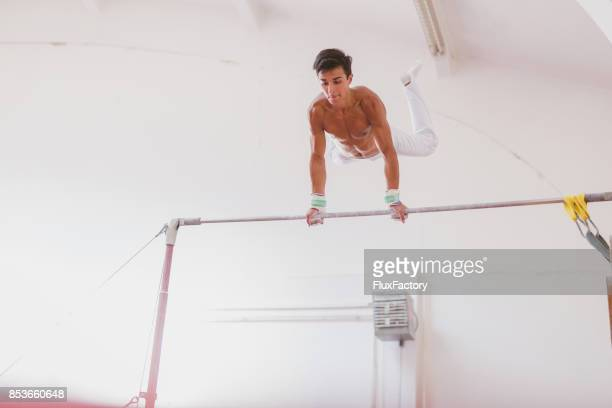Young man working out on horizontal bar