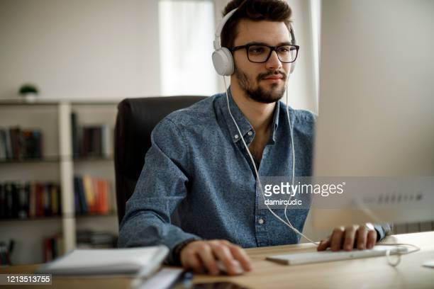 young man working - distant stock pictures, royalty-free photos & images