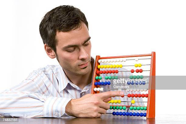Young man with abacus, close-up