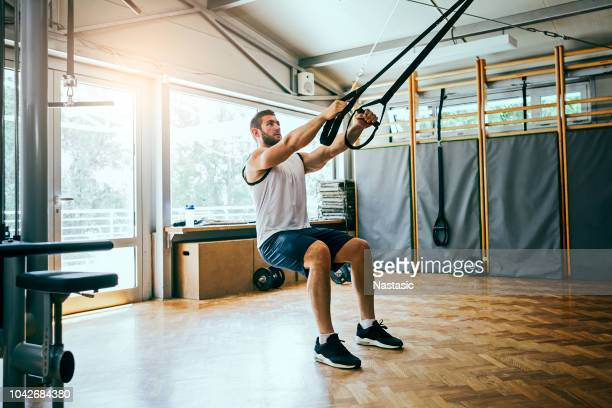 young man workout with trx suspension - strap stock pictures, royalty-free photos & images