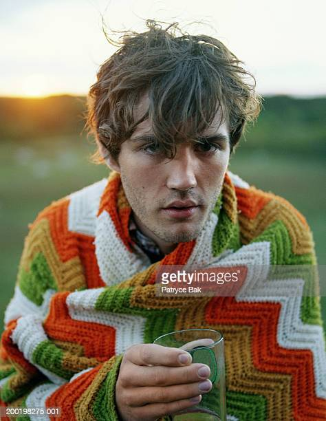 young man wrapped in blanket holding glass, portrait, close-up - 宴の後 ストックフォトと画像