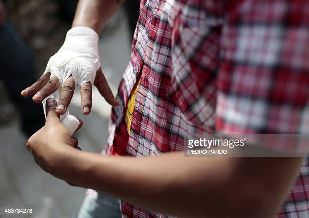 A young man wraps his hands before taking part in a fight representing the Xochimilcas fight to defend their women against the Aztecs in the Mexican...