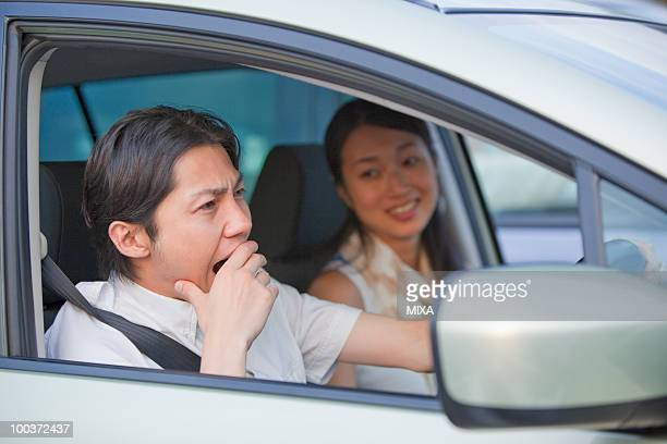 Young Man Yawning at Driver's Seat